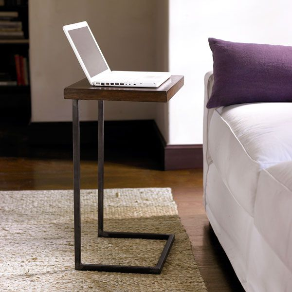 "Multifunctional Table | Side Tables    We can think of so many ways to use this table that we can hardly think of a reason not to have one. It works as a simple laptop table, a television tray, or side table. And, to beat it all, it's handmade!     Handmade of sheesham wood and iron  Many, many uses  Sleek design      Dimensions: 18""w x 13.75""d x 26.75""h"