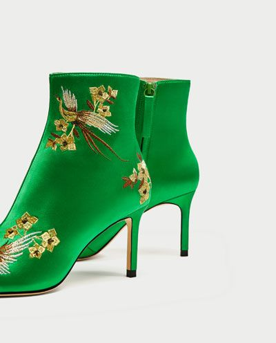 Live like royalty in these emerald satin booties with embroidery.