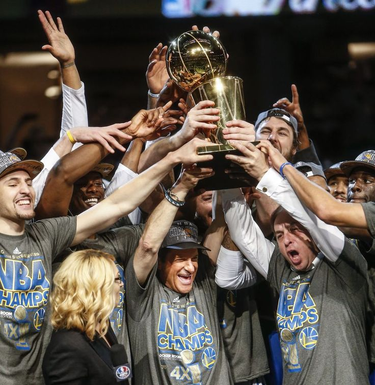 Golden State Warriors' owners Peter Guber and Joe Lacob hold up the Larry O'Brien Championship Trophy after Game 6 of The NBA Finals between the Golden State Warriors and Cleveland Cavaliers at The Quicken Loans Arena on Tuesday, June 16, 2015 in Cleveland, Ohio. The Golden State Warriors defeated the Cleveland Cavaliers 105 to 97 to win the NBA Finals title 4 games to 2.