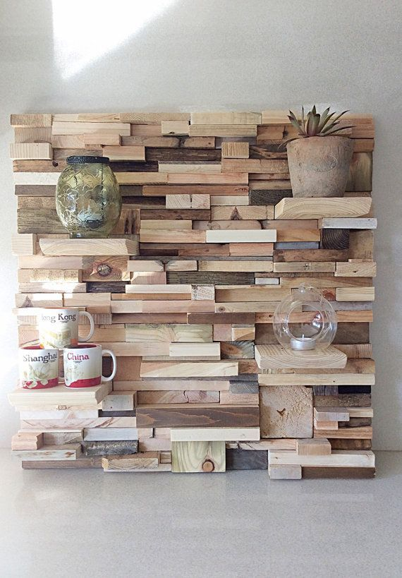 Bespoke Wall Art.  Handmade in our studio with love and assorted reclaimed wood. Fully functional with four small shelves to display your beloved #home #decor items . Dimensions  width 60 cm  Height 57 cm Depth 4 cm - 13 cm  Comes complete with  rear hooks attached for immediate hanging. Thank you xxx