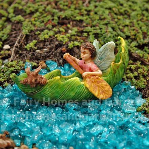 A little fairy boy and and his rabbit sidekick are paddling along in their leaf canoe.