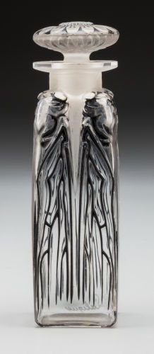 R. Lalique Clear Glass Quatre Cigales Perfume with Black Enamel. Circa 1910. Engraved R. Lalique.