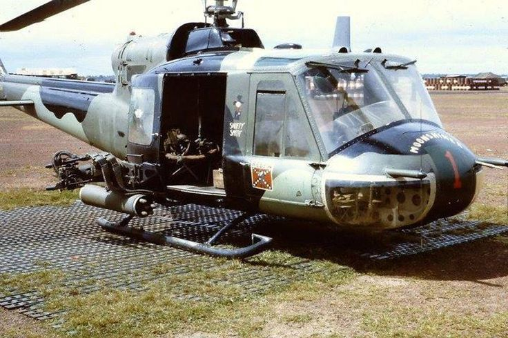 'Snuffy Smith', A Co 1st Avn Bn, 1st Inf Div. The 1st Avn Bn, 1st ID has camouflaged Hueys in this scheme. They were one of few US Army units in Vietnam to do this outside of the US Air Force 20th SOS 'Green Hornets' where it was standard.