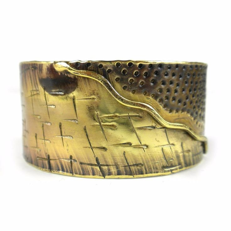 Whether it is sea and land or mountain and sky, nature converges on this brass cuff handmade by South African artisans. The coloration of the brass is achieved by applying high heat rather than paints or dyes. Bracelet dimensions: 30 mm wide by 7 inches long.