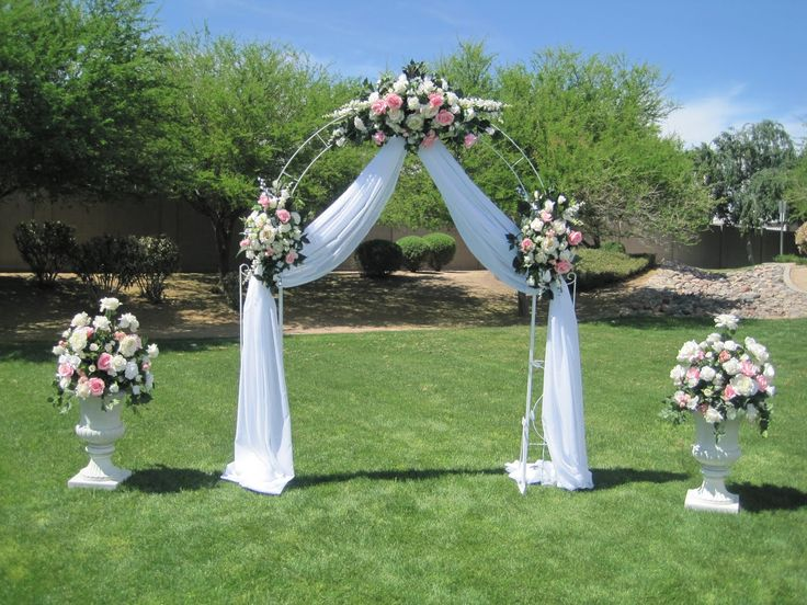 Wedding Arch Ideas | White wrought iron arch, 3 white floral swags, voile draper…