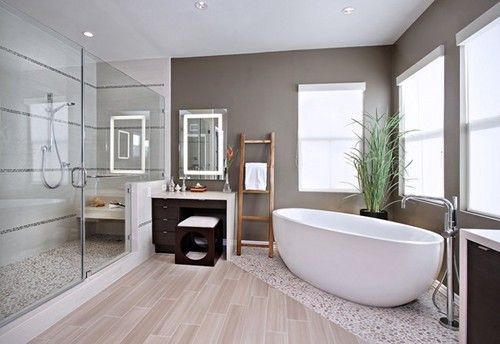 LOVE this! Ceramic wood, mixed with river pebble flooring. Glass shower. CLean lines. Bright and airy, neutral.