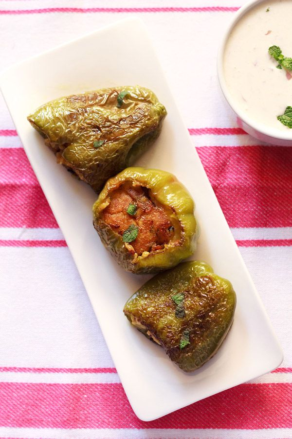 stuffed capsicum or bharwan shimla mirch recipe - green bell peppers stuffed with spiced potatoes. step by step recipe.