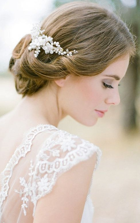 Soft brunette updo with white pearl hair comb. Pearls and lace a feminine elegant wedding combination in white.