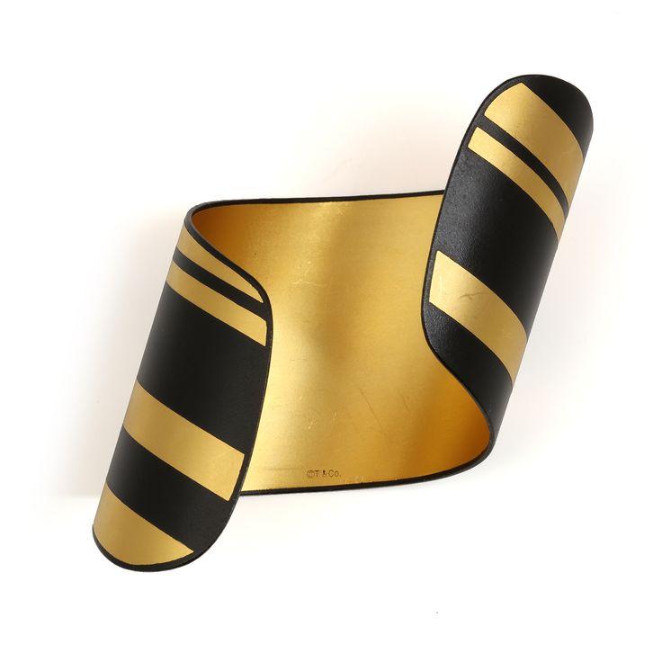 TIFFANY & CO. A black iron and gold damascene cuff
