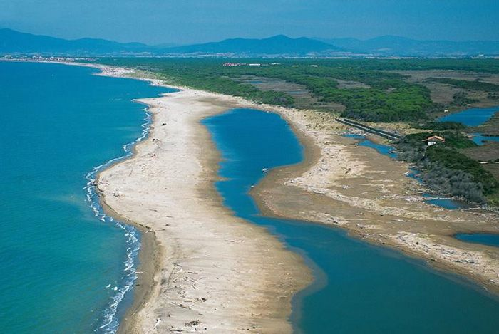 The most beautiful beaches of Tuscany | The Ombrone River Delta located along the coast of Maremma Grossetana, where it flows into the Tyrrhenian Sea.