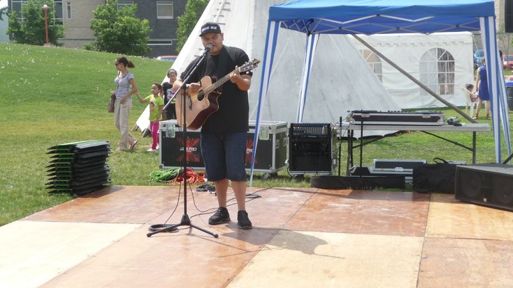 Leonard Sumner an aboriginal musical artist performs at Aboriginal Day live min-stage area south of Scotiabank stage at The Forks