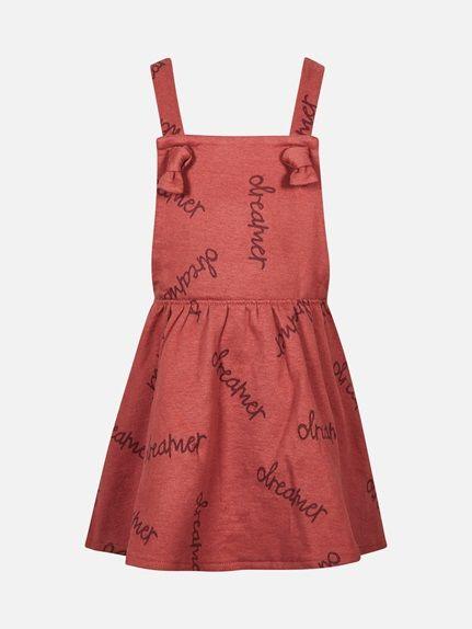 Svanemerket selekjole i sweatshirt kvalitet med mykt fôr på innsiden. Selene har dekorative knuter foran på kjolen og er regulerbare med knapp bak i ryggen. Rustrød
