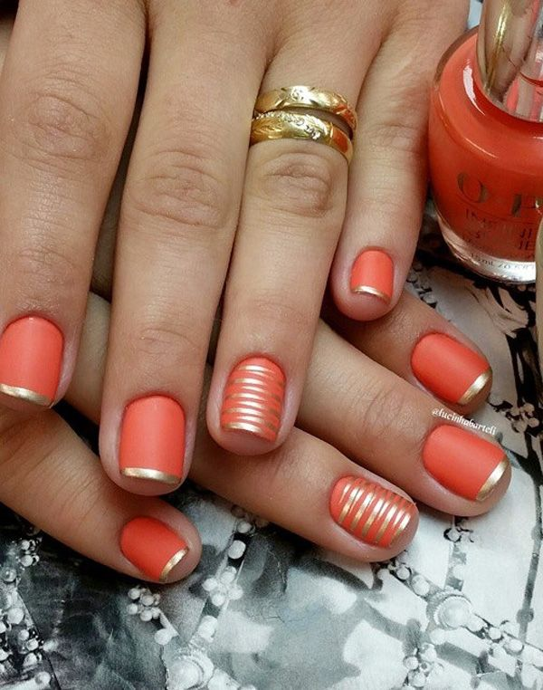 Gold and orange French tips. Tip your nails in gold nail polish above a base of matte orange. Add more flavor to the design by painting golden stripes over the base.