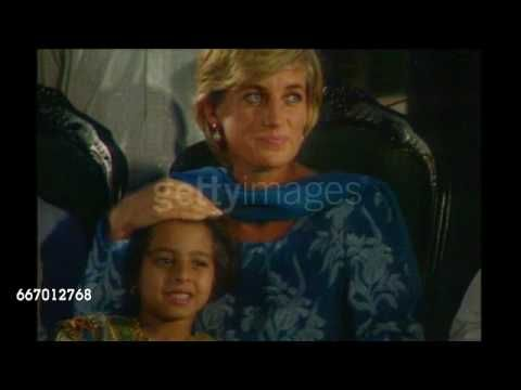 May 23, 1997  **Beware Flash Photography **  Princess Diana, wearing a long blue dress with scarf round her neck (Salwar Kameez) seated with a small girl on her visit to 'Shaukat Khanum Memorial Cancer Hospital and Research Centre' in Lahore, Pakistan. Video.