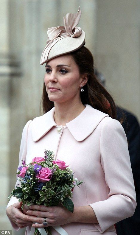 Pretty: The Duchess of Cambridge wore her hair half up, which showed off a pair of dazzlin...