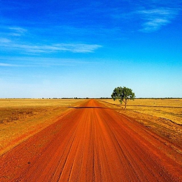 This vast part of Australia (road to Tennant Creek, Northern Territory) has brilliant blue skies and boundless horizons that are broken only by kangaroos darting across the highway, soaring eagles, remote pubs and ancient rock art (image by Paul Arnold Photography)