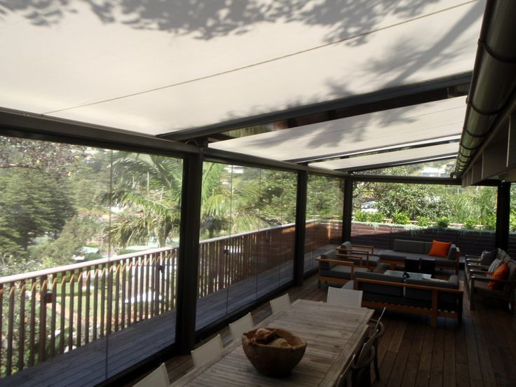 Outrigger's clear pvc motorised side screens in tracks enclose this large verandah to create a cosy outdoor room for cooler months.