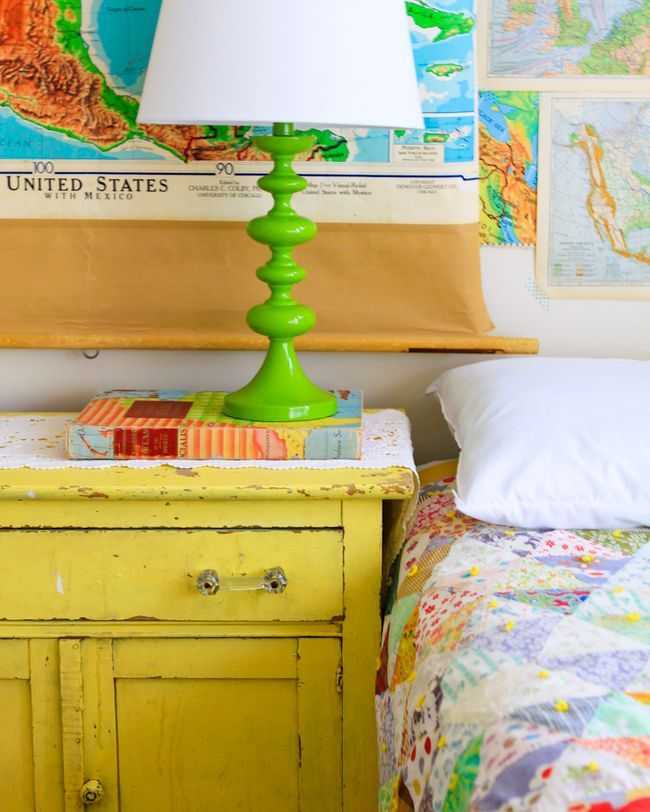 The lamp, the quilt, the chippy yellow furniture, the vintage maps...awesome!  Meg Duerksen's craft house
