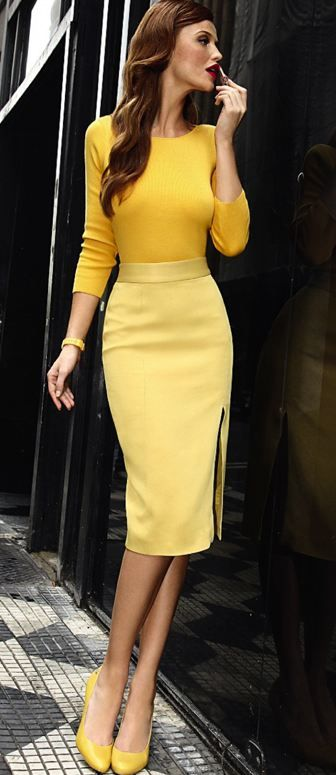 Banana slim skirt in a below the knee look.  Bright golden bee 3/4 sleeves.  Yellow outfit.
