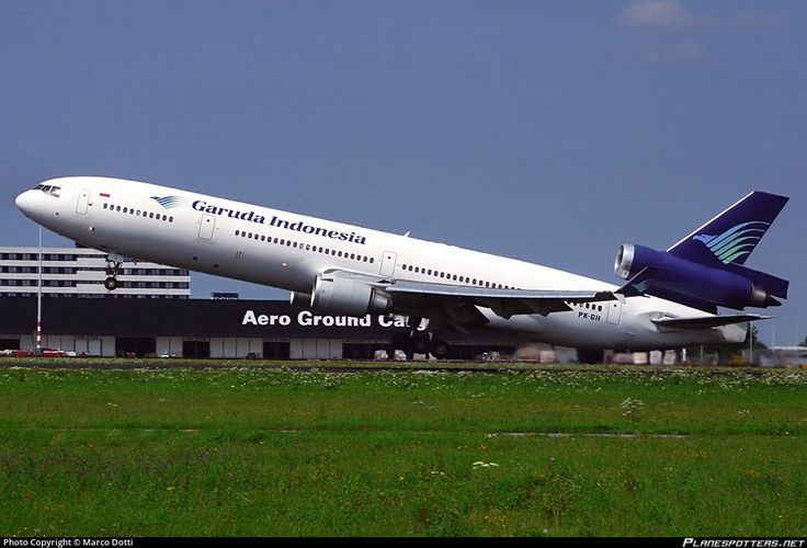 Garuda Indonesia McDonnell Douglas MD-11 PK-GII touching down at Amsterdam-Schiphol, August 1996. (Photo: Marco Dotti)