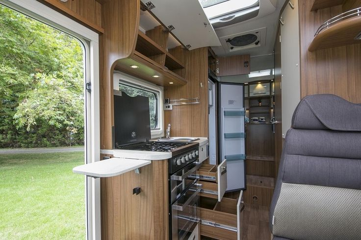 Inside the Hymer ML T580 luxury campervan:Kitchen with generous storage and extendable worktop means you don't have to leave your inner chef at home. Feel free to use this image but give credit to http://smartrv.co.nz/motorhomes-for-sale/german/hymer/ml-t-580-4x4