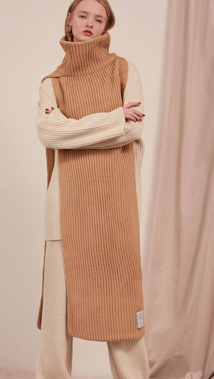 The Sancia, ribbed knit cowl turtleneck scarf in extra long in length. Can be worn in two ways. COMPOSITION AND CARE Dry clean only Updating soon SIZE AND FIT One size length 47.75 inches. Width 15.5