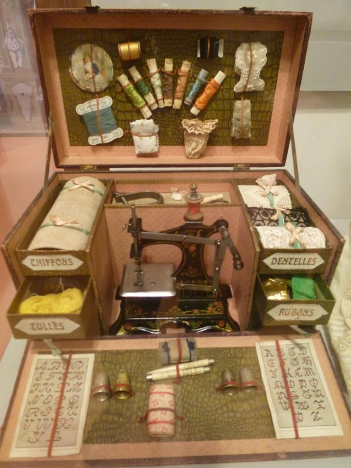 Antique sewing machine. Toy set... my how childhood activities have changed!