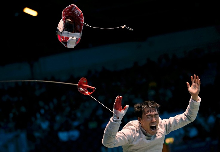 South Korea's Woo Young Won celebrated after his men's saber team quarterfinals fencing match against Germany's Nicolas Limbach (2012 Olympics)