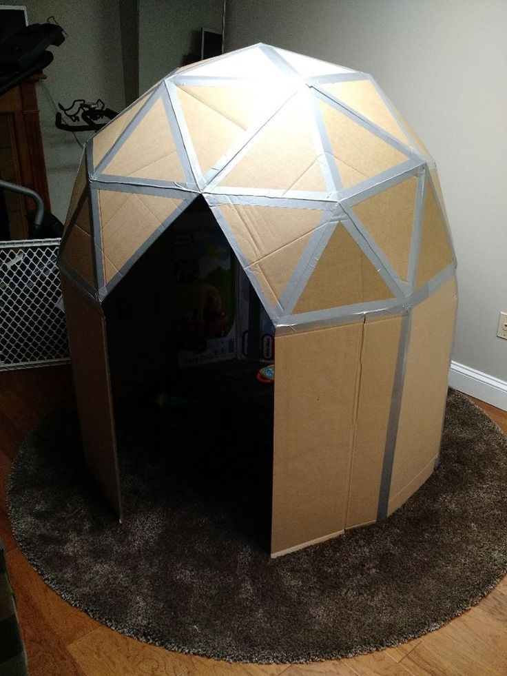 I wanted to make a small play house for the kids, but I didn't want to spend money.  Aside from a $3 pack of hot glue sticks, everything I used here is stuff I already had. I searched online for geodesic domes so I wouldn't have to do all the math myself.  I found a suitable one that people suggested homeless people use as emergency shelter, then scaled it down and added squares on the bottom. For this project, I used: cardboard box cutter pen or pencil ruler hot glue white school…