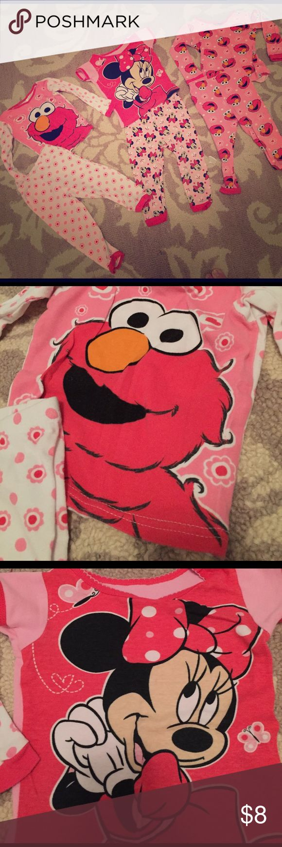 Toddler girl PJS  All in good condition . Except minor flaw in the little Elmo pjs some of the stitches came out bottom on shirt  ( see picture). And both Elmo pjs have the tags taken off because my daughter hated them . Elmo pjs are 2t and Minnie is 24 months Disney Pajamas Pajama Sets