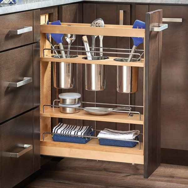 Rev-A-Shelf's beautiful base organizers feature adjustable shelves with chrome rails to help keep everything in its place. Stop digging through drawers for utensils and say goodbye to unsightly, space monopolizing counter bins with the pullout designed specifically for storing a multitude of utensils. Units glide out on the blumotion soft close slide system, which is some of the industry best slides. Door mounting is easy with patented door mount brackets that provide of flexibility for t...