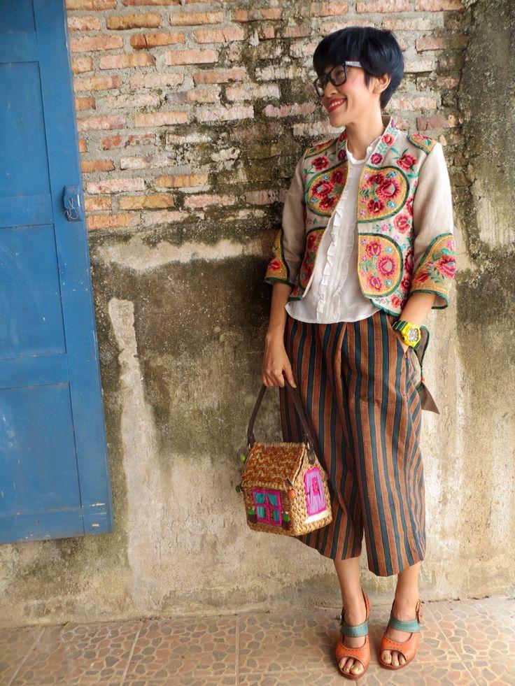 Batik Amarillis's creative director Selly Hasbullah wearing Batik Amarillis's Arcana jacket#3 in Hungarian embroidery features tenun gedog Tuban and blogger wrap pants in Lurik surjan of yogjakarta ,also Ray Ban wayfarer glasses.