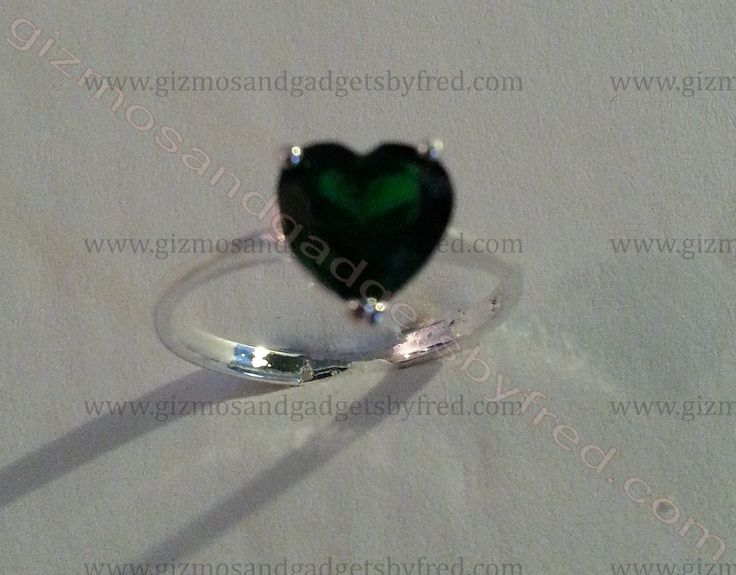 Beautiful sterling silver ring. Green Heart shaped cubic zirconia. Can be found at gizmosandgadgetsbyfred.com