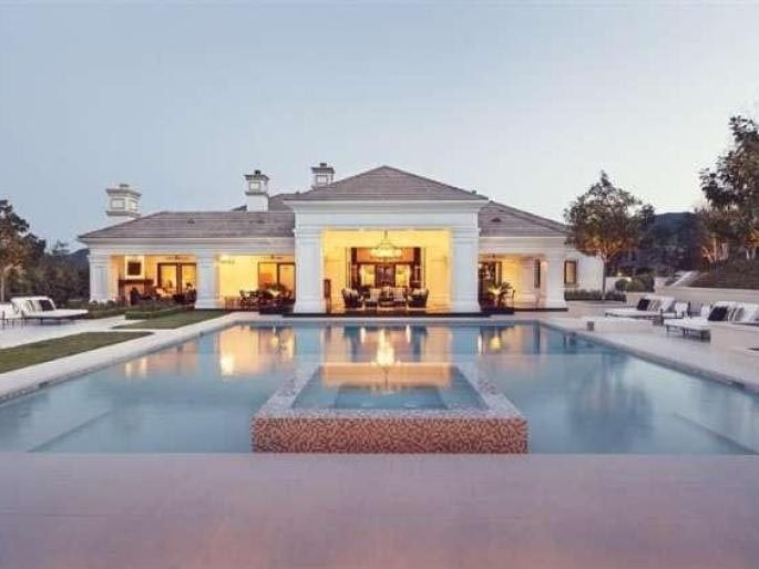 """Wayne Gretzky and his wife Janet figure now is a good time to sell their California mansion.  According to celebrity real estate blogger The Real Estalker, the Gretzkys bought the home in November 2009 and gave it a makeover """"that included the addition of the swimming pool and accessory structures in the backyard.""""  How much for the 8,711 square foot single-story home? The couple is asking $10.5 million for the property located in Thousand Oaks, Calif."""