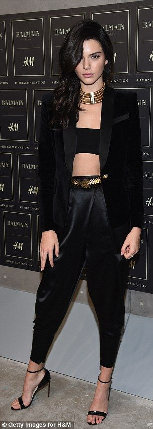 Model muse: Kendall opted for a bandeau top and satin harem pants with stiletto heels