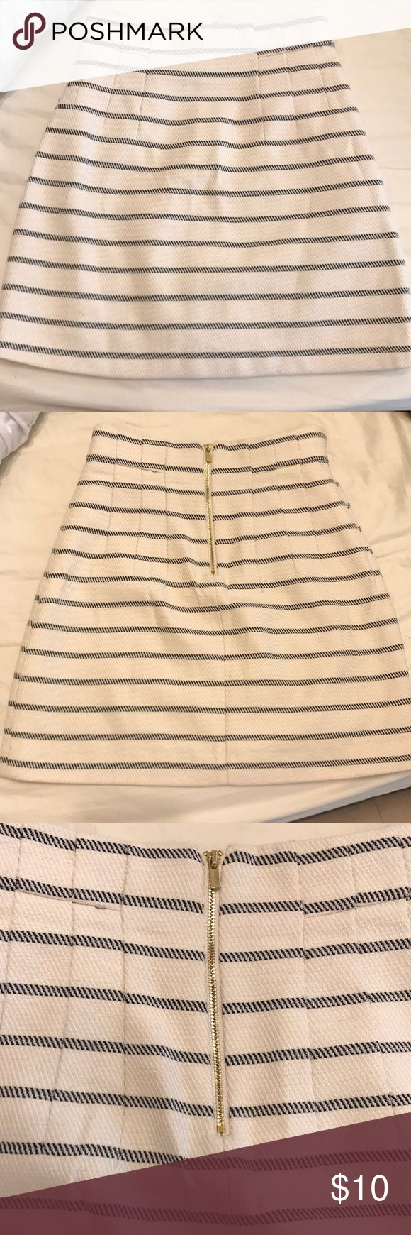 H&M Striped Creme and Navy Career Skirt H&M creme knit career skirt with navy stripes. Lined on the inside. Falls mid thigh. Pleated at waist. Back gold zipper detail. H&M Skirts Mini