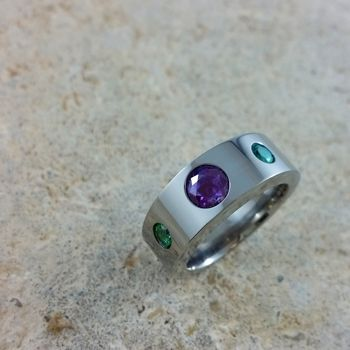 From Scott, about his very own custom-made titanium ring adorned with a 6mm Alexandrite and 4mm Rainforest Topaz : Received the ring yesterday.  It is beautiful.  Thank you all for doing such outstanding work.
