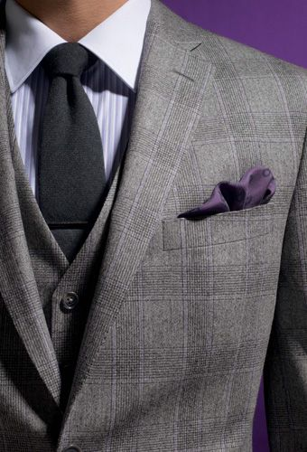 Square gray suit and vest, Darker gray tie, striped white and gray Shirt & a purple handkerchief.
