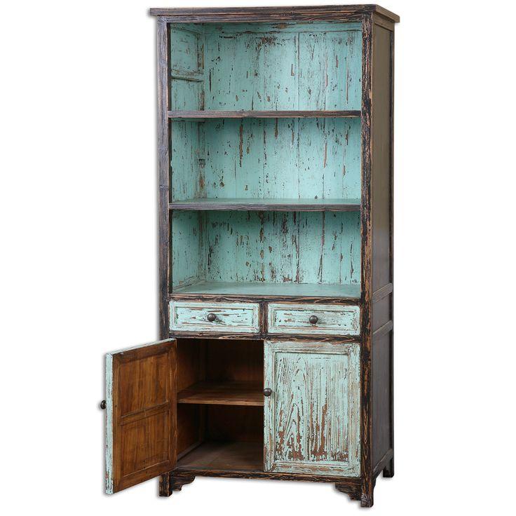 Великолепный, яркий шкаф в потертой голубой отделке с черными оттенками. Множество удобных полок и выдвижных ящиков поможет Вам с организацией пространства. Ваши любимые книжки обязательно найдут свое место в этом чудесном шкафу. Для изготовления шкафа ис...             Материал: Дерево.              Бренд: Uttermost.              Стили: Прованс и кантри.              Цвета: Голубой.