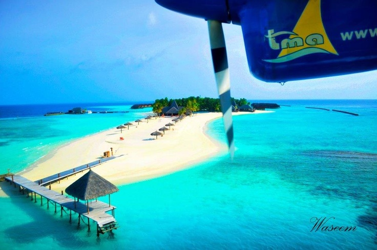 TMA seaplane landing at Veligandu Island Resort, Maldives
