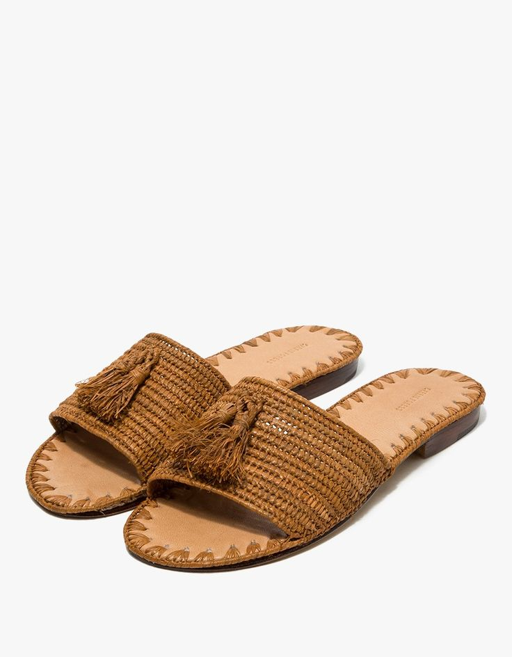 From Carrie Forbes, a minimalist sandal in Cognac. Featuring a handwoven raffia upper, handwoven raffia tassels, Italian leather sole, branded insole and a slightly stacked heel. • Sandal in Cognac • Handwoven raffia upper • Handwoven raffia tassels