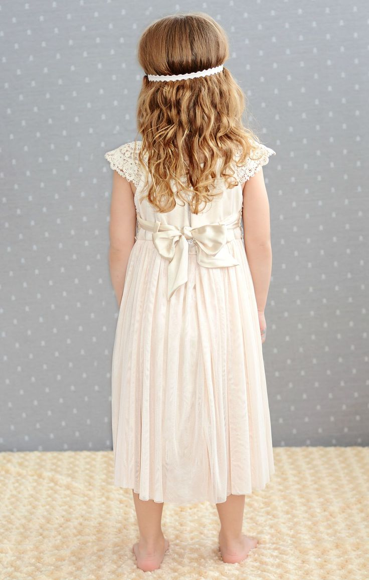 This crochet lace dress is just adorable. Great quality and so versatile! Perfect for a flower girl dress or the family photos!