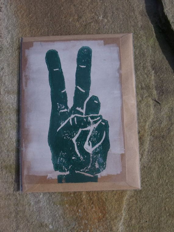 Handprinted woodblock peace and victory hand sign by BarnesGoodman