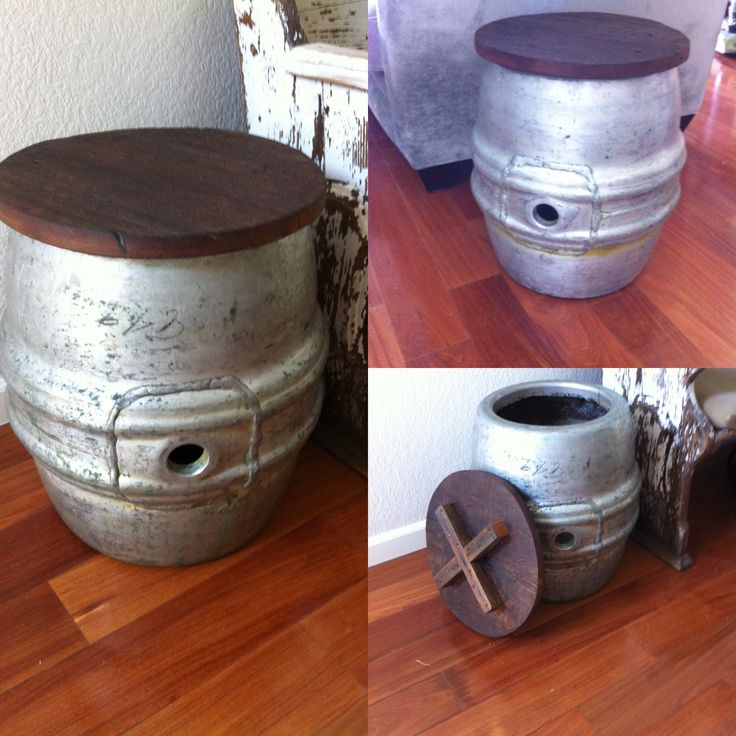 Vintage beer keg side tables with removable barn wood tops.