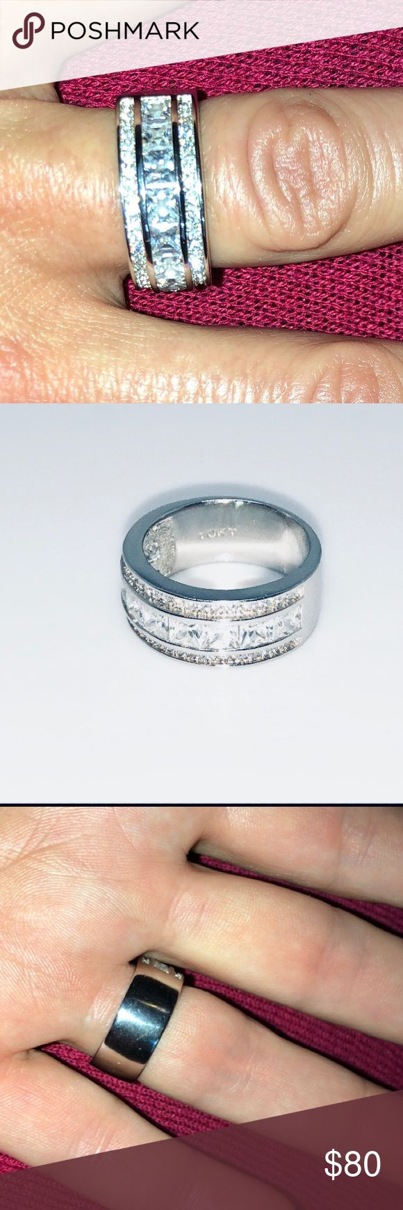 10k White Gold Filled AAAAA 3Ct PrincessCut Sz 7.5 10k White Gold Filled (5)AAAAA 3 Carat Princess Cut invisible Setting 9 Stones Plus Top and Bottom Channel Set Round Stones. (5)A CZ's Cover Half of the Entire Band. Stamped 10k. Wedding Band Material✔️ Ring Size 7.5 Jewelry Rings