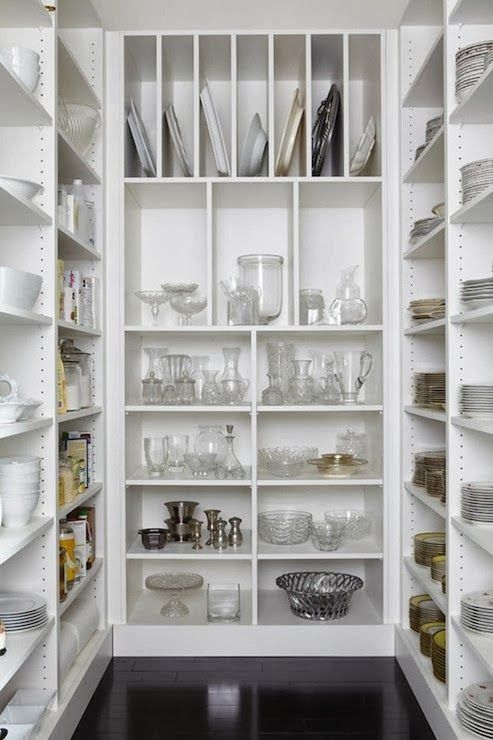 KITCHEN SHELVES :: Simple shelving/storage, but the pieces, themselves, make this space...