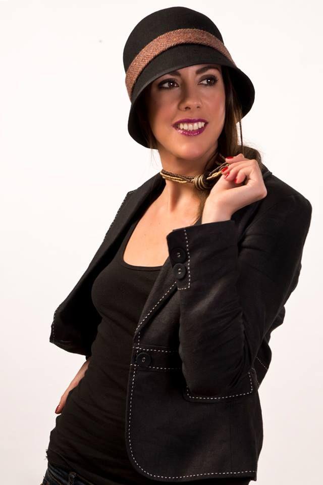 Black wool felt cloche with Irish Tweed trim, Highbury by Amanda Byrne, The Irish Collection. Model - Monica Manzzi Barlocco Photographer - Peter Keane MUA - Christine Penston