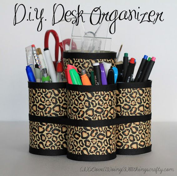 DIY organizer made from aluminum cans and patterned duct tape.