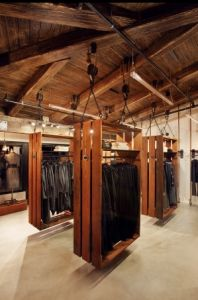 This would make for a cool closet in a home somewhere! Suspended wood fixtures by Nicole Hollis