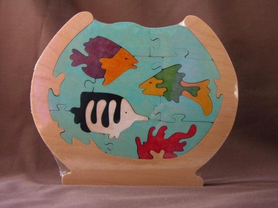 Hey, I found this really awesome Etsy listing at http://www.etsy.com/listing/62497079/life-in-a-fish-bowl-colorful-wood-puzzle